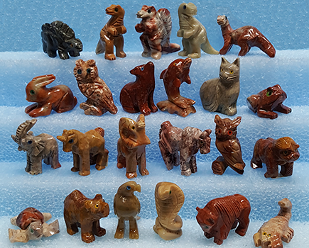 Hand carved soapstone animals crafted from natural stone