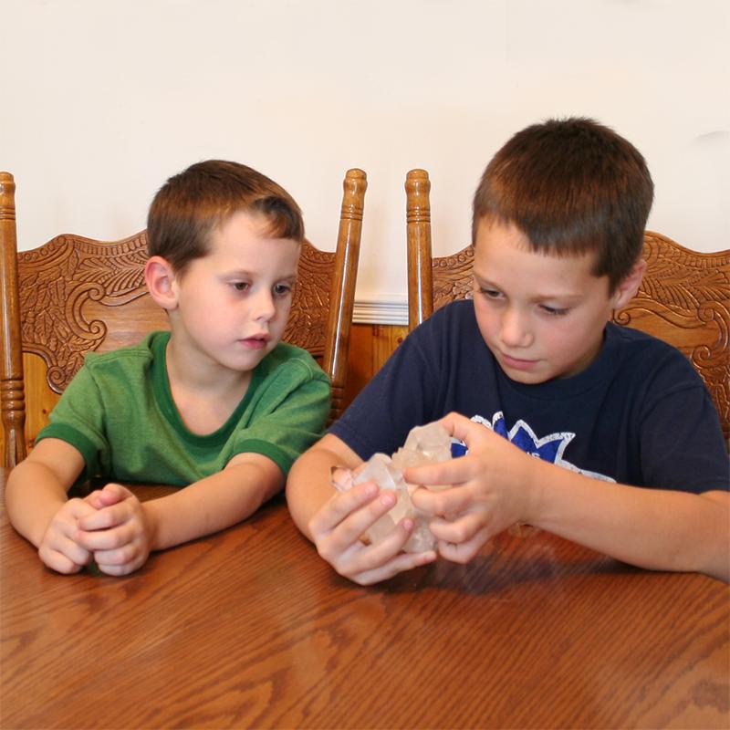 Kids-looking-at-a-quartz-crystal