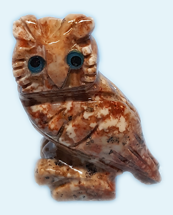 Soapstone owl is a hand carved animal from natural stone